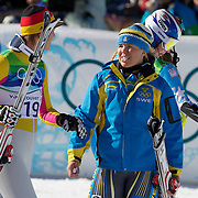 Winter Olympics, Vancouver, 2010.Gold medal winner Maria Riesch, Germany, (left) with bronze medal winner Anja Paerson, Sweden as Lindsey Vonn, USA, whoc crashed out walks past during  the Ladies Super Combined during competition at Whistler Creekside, Whistler, during the Vancouver Winter Olympics. 18th February 2010. Photo Tim Clayton