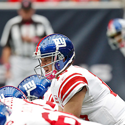 October 10, 2010; Houston, TX USA; New York Giants quarterback Eli Manning (10) under center against the Houston Texans at Reliant Stadium. Mandatory Credit: Derick E. Hingle