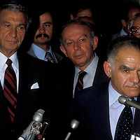 U.S. envoy to the Middle East Sol Linowitz stands to the left of Israeli Foreign Minister Yitzhak Shamir at the U.S. State Department in September 1980. The man is the middle is unknown.