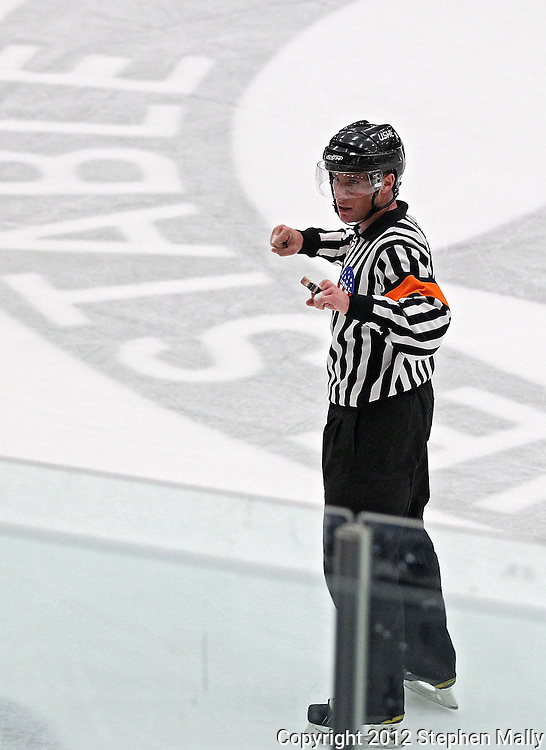 Referee Andrew Wilk signals a cross checking penalty during the game at the Cedar Rapids Ice Arena, 1100 Rockford Road SW in Cedar Rapids on Saturday evening, February 18, 2012. (Stephen Mally/Freelance)