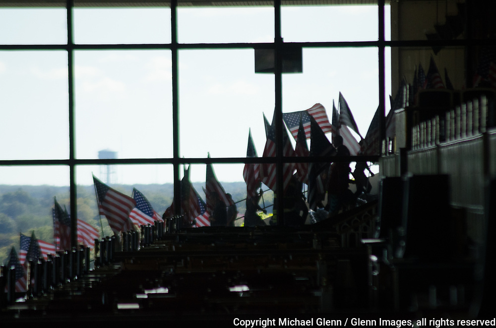 1 Oct 2017 Elmont, New York United States of America // Flag bearers silhouetted against the background at the 3RD annual national stair climb for fallen firefighters at the Belmont Park racetrack  Michael Glenn  /   for the FDNY