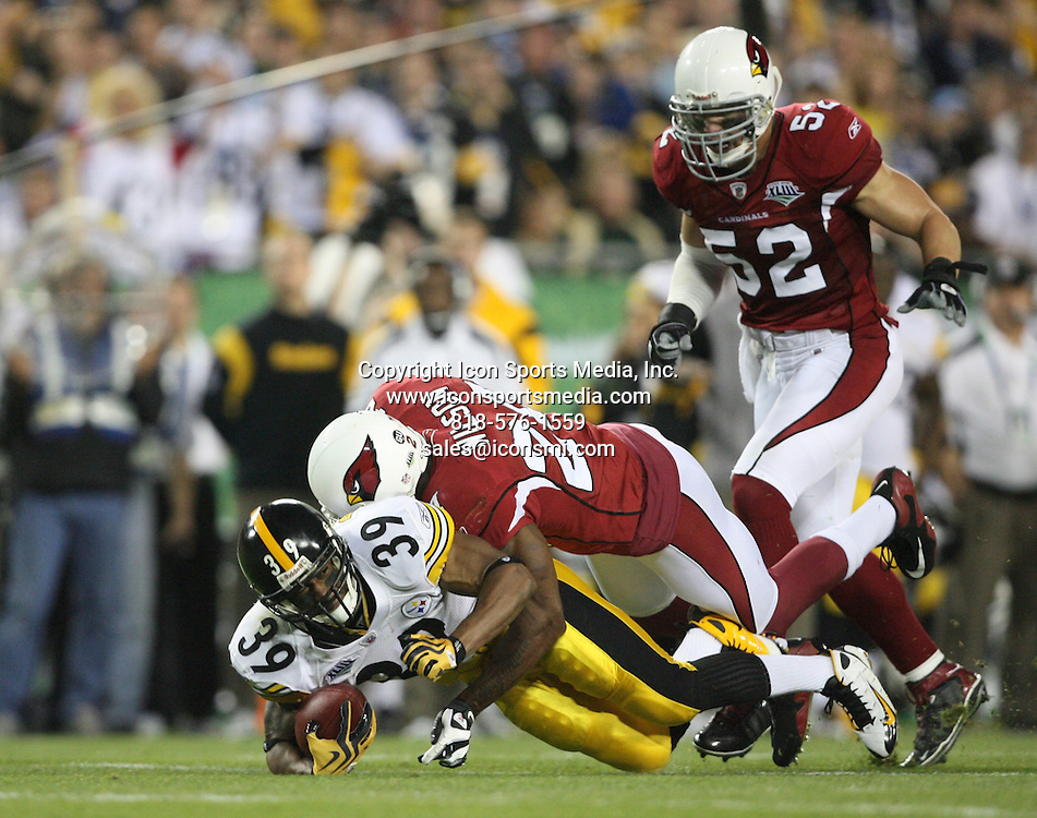 Feb 01, 2009 - Tampa, Florida, USA - Pittsburgh's Willie Parker (39) is tackled by Arizona's Adrian Wilson (24) after a catch and a gain of eight yards in the first quarter of Super Bowl XLIII between the Arizona Cardinals and the Pittsburgh Steelers on February 1, 2009 at Raymond James Stadium