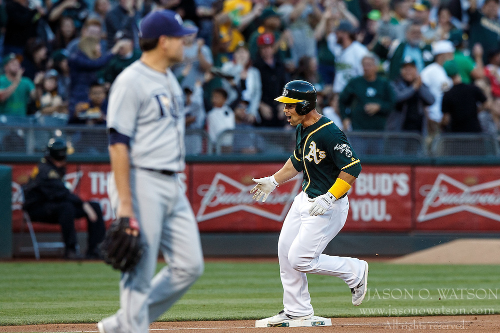 OAKLAND, CA - JULY 21:  Jake Smolinski #5 of the Oakland Athletics celebrates while rounding the bases after hitting a three run home run off of Matt Moore #55 of the Tampa Bay Rays during the second inning at the Oakland Coliseum on July 21, 2016 in Oakland, California. (Photo by Jason O. Watson/Getty Images) *** Local Caption *** Jake Smolinski; Matt Moore