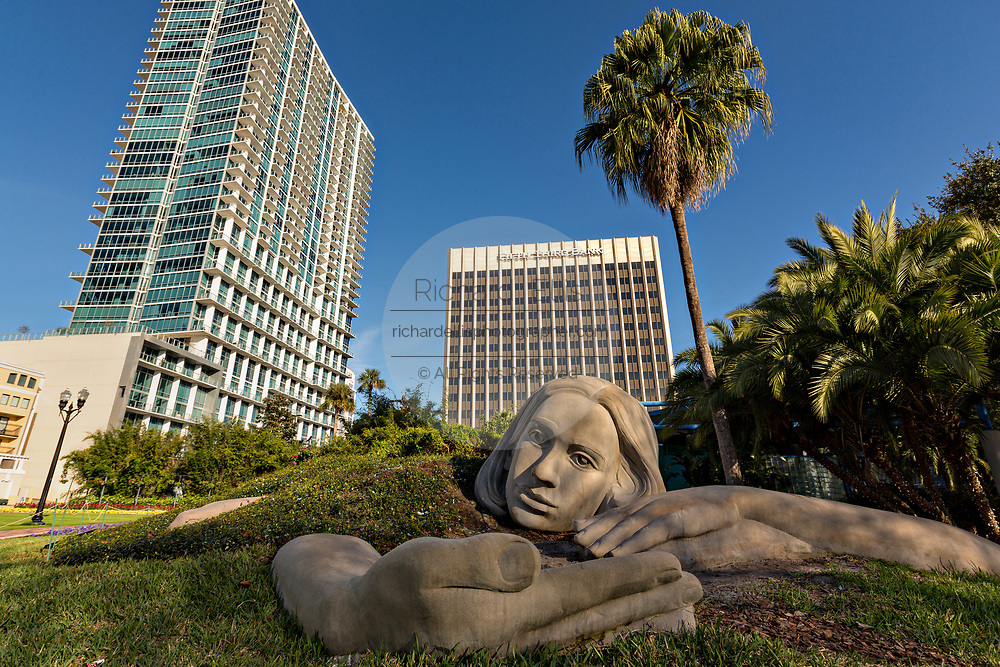 Monumental sculpture Muse of Discovery by artist Meg White along Lake Eola Park in Orlando, Florida. Lake Eola Park is located in the heart of Downtown Orlando and home to the Walt Disney Amphitheater.