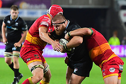 Ospreys' Dimitri Arhip is tackled by Dragons' Cory Hill - Mandatory by-line: Craig Thomas/JMP - 27/10/2017 - RUGBY - Liberty Stadium - Swansea, Wales - Ospreys v Dragons - Guinness Pro 14