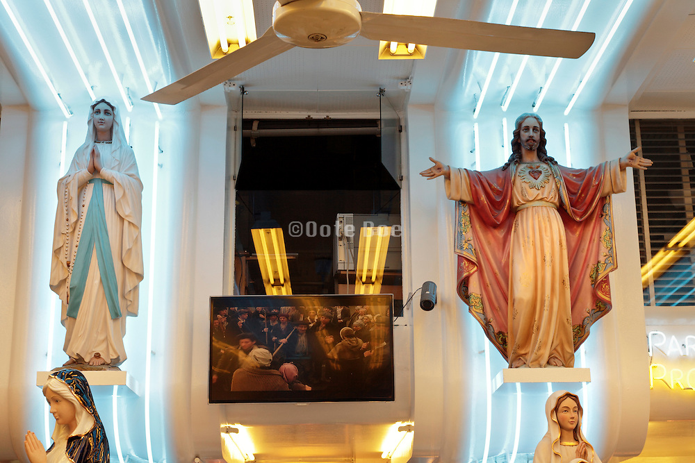 Statues of Mary and Jesus Christ at a souvenir shop in Lourdes, France