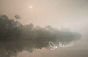 Smoke from nearby forest fires obscures the sunrise over the Sekonyer river in Southern Borneo along the Tanjung Puting National Park, Indonesia.