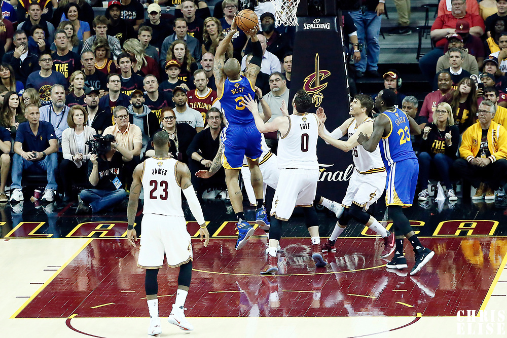 07 June 2017: Golden State Warriors forward David West (3) goes for the jump shot past Cleveland Cavaliers forward Kevin Love (0) during the Golden State Warriors 118-113 victory over the Cleveland Cavaliers, in game 3 of the 2017 NBA Finals, at  the Quicken Loans Arena, Cleveland, Ohio, USA.