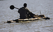 Africa, Ethiopia, Blue Nile river man in a dugout canoe