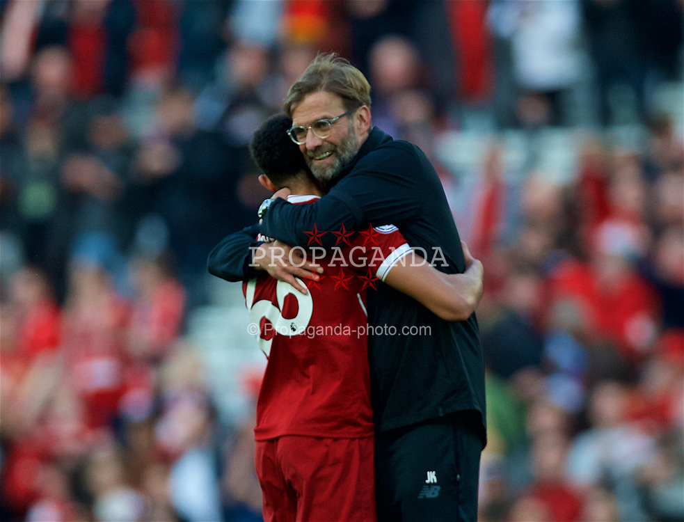 LIVERPOOL, ENGLAND - Saturday, April 14, 2018: Liverpool's manager Jürgen Klopp embraces Trent Alexander-Arnold after the 3-0 victory during the FA Premier League match between Liverpool FC and AFC Bournemouth at Anfield. (Pic by Laura Malkin/Propaganda)