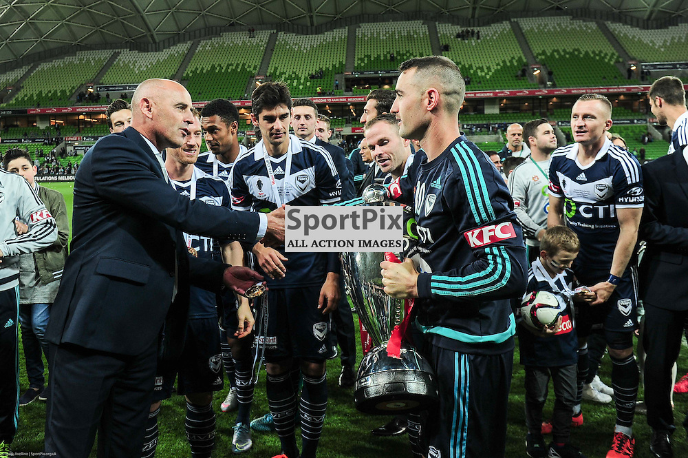 Head coach of Melbourne Victory Kevin Muscat hands sent off captain Carl Valeri the cup and medal after their 2:0 win over Perth in the Westfield FFA Cup Final, 7th November 2015, Melbourne Victory FC v Perth Glory FC - © Mark Avellino | SportPix.org.uk