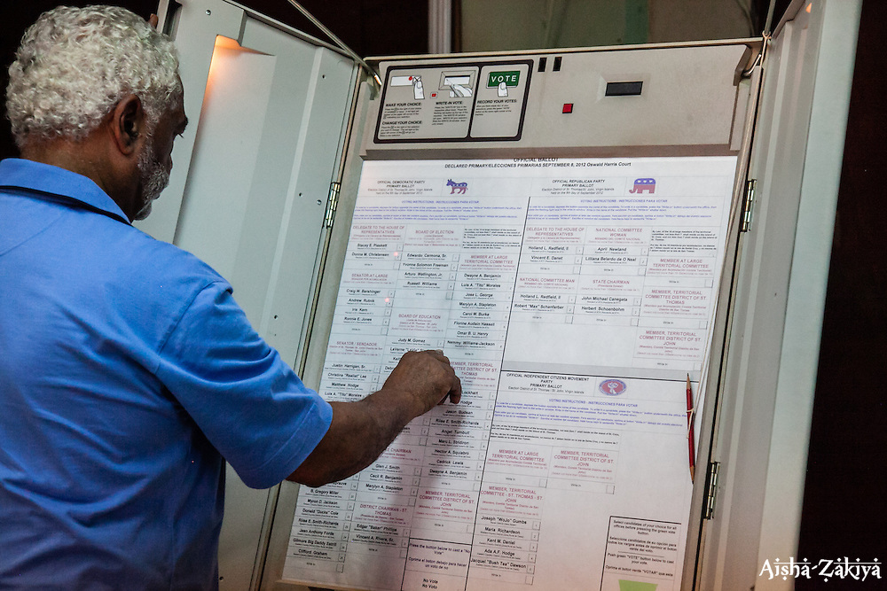 Mr. Hulbert Lewis begins testing the voting machines that will be used in the primary election.  Board of Elections.  31 August 2012.  © Aisha-Zakiya Boyd