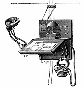 Telephone apparatus available to New York subscribers. This used an Edison transmitter and a 'pony crown' receiver (lower right of picture. Wood engraving c1891.