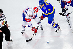 Matej Hocevar of Slovenia vs Oleg Shafarenko of Ukraine during ice-hockey match between Slovenia and Ukraine at IIHF World Championship DIV. I Group A Slovenia 2012, on April 19, 2012 in Arena Stozice, Ljubljana, Slovenia. (Photo by Vid Ponikvar / Sportida.com)