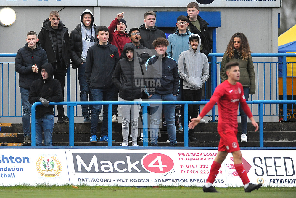 TELFORD COPYRIGHT MIKE SHERIDAN Curzon Ashton supporters offer a welcome to Telford's Ryan Barnett during the Vanarama National League Conference North fixture between Curzon Asthon and AFC Telford United on Saturday, November 9, 2019.<br /> <br /> Picture credit: Mike Sheridan/Ultrapress<br /> <br /> MS201920-028