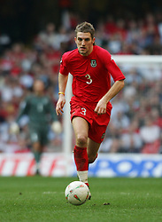CARDIFF, WALES - SATURDAY MARCH 26th 2005: Wales' Sam Ricketts in action against Austria during the Wold Cup Qualifying match at the Millennium Stadium. (Pic by David Rawcliffe/Propaganda)