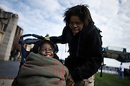 "OHIO, Toledo, October 27, 2012:  Mother and daughter arriving to the event organized by the church organization ""1Matters.org"" in Toledo to help homeless and people living below the poverty line. ALESSIO ROMENZI"