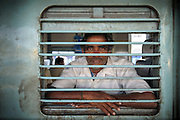 Man on a Train - Nampally, Hyderabad, India