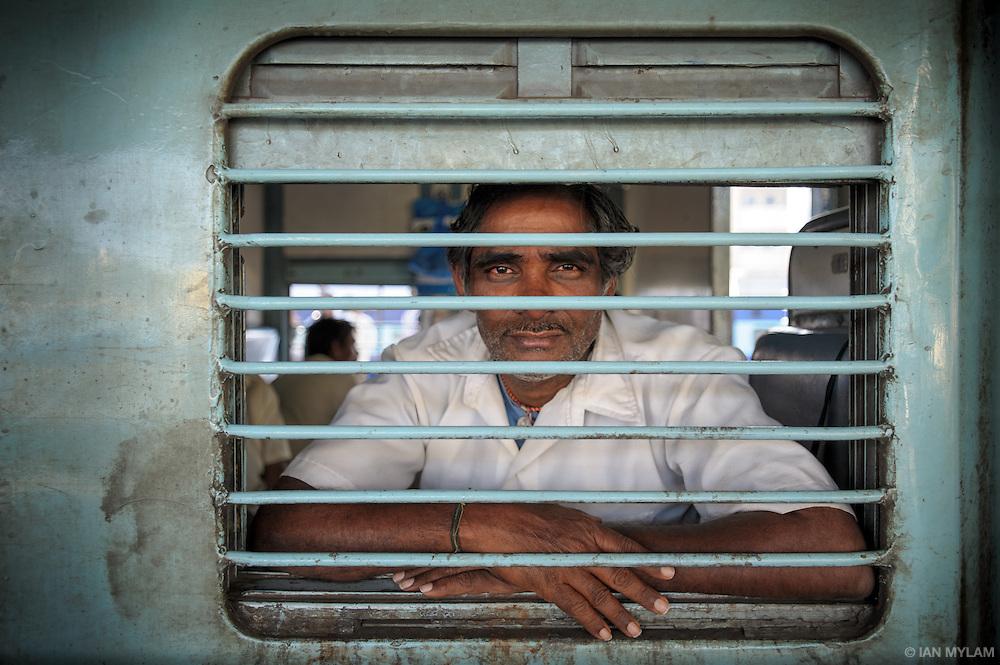 Man on a Train - Nampally, Hyderabad, India