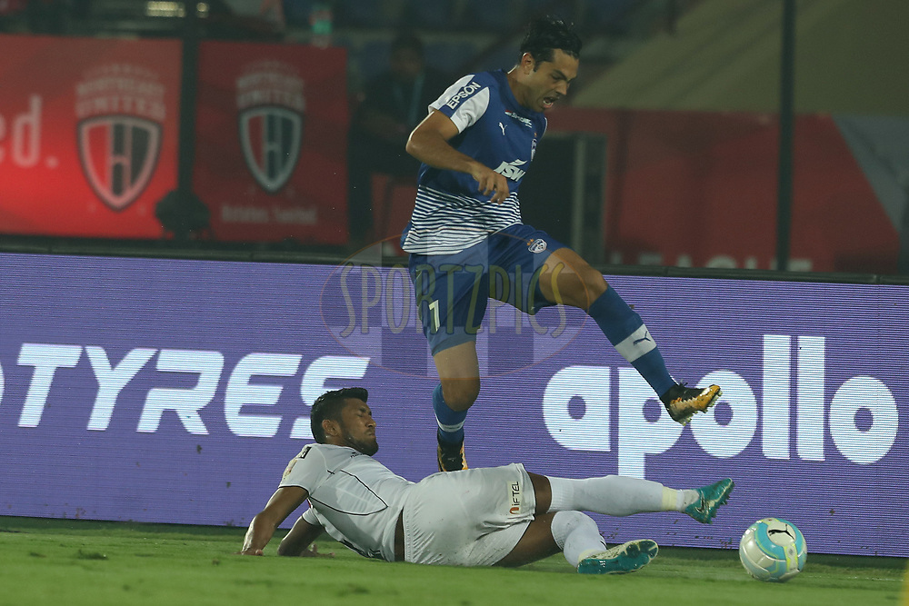 Nirmal Chettri of Northeast United FC and Nicolas Ladislao Fedor of Bengaluru FC during match 19 of the Hero Indian Super League between NorthEast United FC and Bengaluru FC held at the Indira Gandhi Athletic Stadium, Guwahati India on the 8th December 2017<br /> <br /> Photo by: Ron Gaunt / ISL / SPORTZPICS