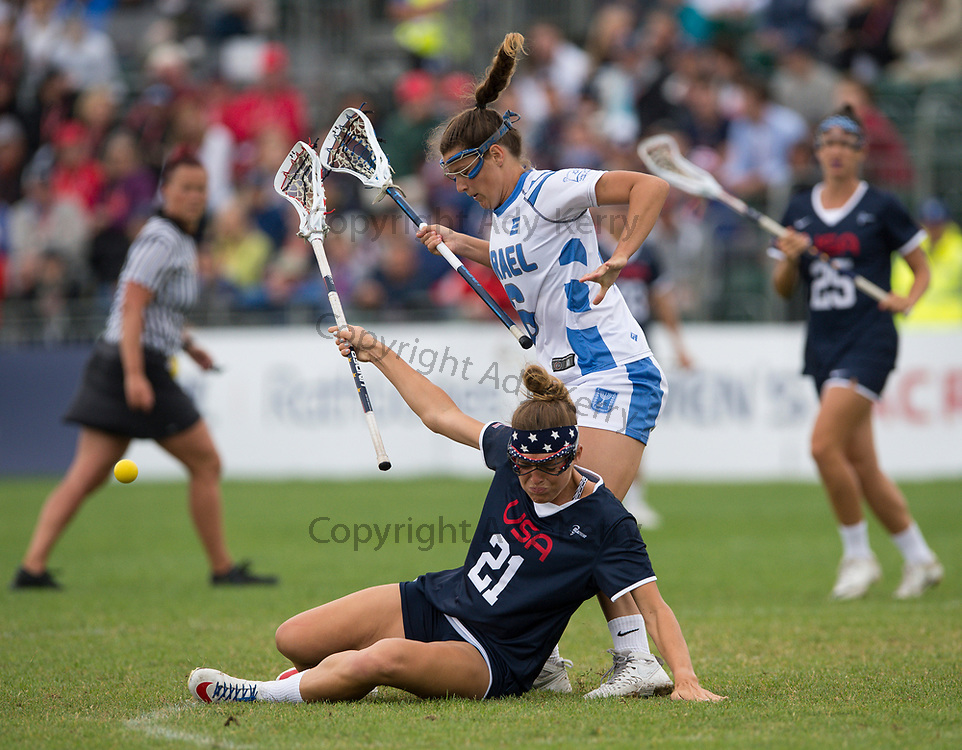 USA's Taylor Cummings goes down under a challenge from Israel's Sarah Andersen at the 2017 FIL Rathbones Women's Lacrosse World Cup, at Surrey Sports Park, Guildford, Surrey, UK, 19th July 2017.