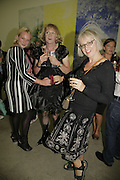 LOUISA BUCK, GRAYSON PERRY AND PHILLIPA PERRY, Johnnie Shand Kydd:  book launch party celebrate the publication of Crash.White Cube. Hoxton sq. London. 18 September 2006. ONE TIME USE ONLY - DO NOT ARCHIVE  © Copyright Photograph by Dafydd Jones 66 Stockwell Park Rd. London SW9 0DA Tel 020 7733 0108 www.dafjones.com