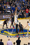 Golden State Warriors center Zaza Pachulia (27) and Houston Rockets center Clint Capela (15) battle for the tip-off at Oracle Arena in Oakland, Calif., on March 31, 2017. (Stan Olszewski/Special to S.F. Examiner)