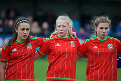 NEWPORT, WALES - Friday, April 1, 2016: Wales' Mesh Dudley-Jones, Morgan Rogers and Alice Griffiths line-up to sing the national anthem before the game against Republic of Ireland during Day 1 of the Bob Docherty International Tournament 2016 at Dragon Park. (Pic by David Rawcliffe/Propaganda)