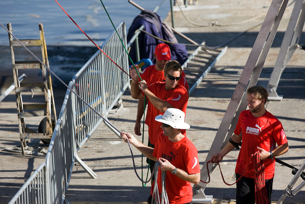 27MAR09 The PUMA Ocean Racing shore crew get to work as soon as the boat arrives on the dock in Rio de Janeiro for the finish of Leg 5 of the Volvo Ocean Race 2008-09.