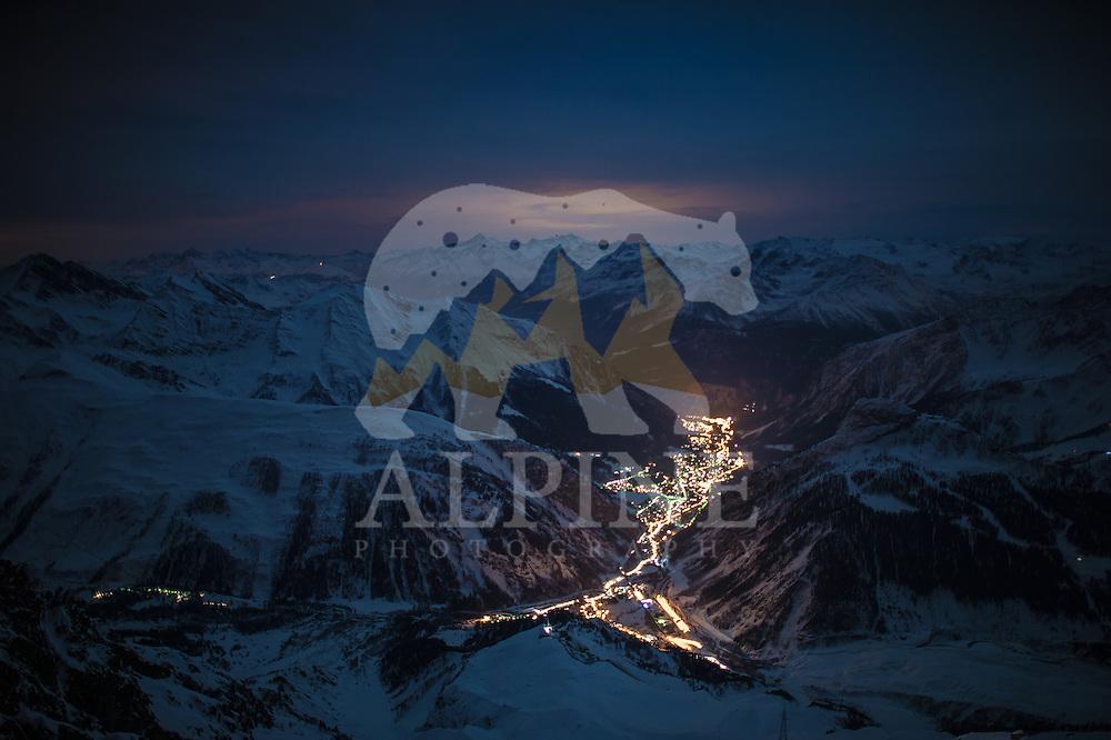 A top-view long exposure photograph of Cormayeur, Aosta Valley as seen on a cold Summer night. Photograph taken from Torino Refuge.