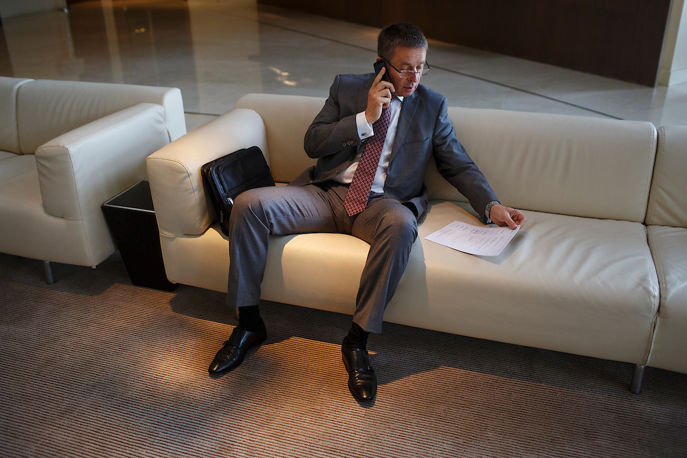 Ivan Mikloš makes a phone call before a meeting in the lobby of the Hyatt hotel on May 25, 2015 in Kyiv, Ukraine. Mr. Mikloš is Chief Advisor to the Minister of Finance of Ukraine and Advisor to the Minister of Economic Development and Trade of Ukraine.