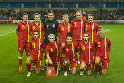 LONDON, ENGLAND - Saturday, October 26, 2013: Wales' players line up for a team group photograph before the FIFA Women's World Cup Canada 2015 Qualifying Group 6 match against England at the New Den. Back row L-R: Helen Ward (nee Lander), Hayley Ladd, Nicola Davies, Kylie Davies, Helen Bleazard, Loren Dykes. Front row L-R: Natasha Harding, Jess Fishlock, Angharad James, Sarah Wiltshire, Sophie Ingle. (Pic by David Rawcliffe/Propaganda)