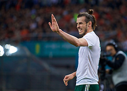 NANNING, CHINA - Thursday, March 22, 2018: Wales' Gareth Bale celebrates scoring the second goal during the opening match of the 2018 Gree China Cup International Football Championship between China and Wales at the Guangxi Sports Centre. (Pic by David Rawcliffe/Propaganda)