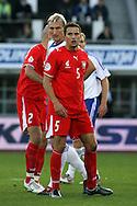 12.09.2007, Olympic Stadium, Helsinki, Finland..UEFA European Championship 2008.Group A Qualifying Match Finland v Poland.Dariusz Dudka (Poland) v Sami Hyypi? (Finland).©Juha Tamminen.....ARK:k