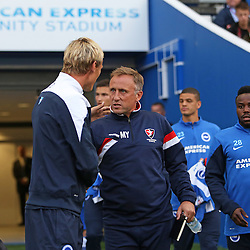 Brighton & Hove Albion's Manager Sami Hypia and Cheltenham Town's Manager Mark Yates during the English Capital One Cup 1st Round between Brighton & Hove Albion FC and Cheltenham Town FC at the American Express Community Stadium, Brighton, 12th August 2014 © Phil Duncan | SportPix.org.uk