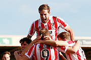 Harry Pell celebrates after Danny Wright scores his second for Cheltenham during the Vanarama National League match between Cheltenham Town and Boreham Wood at Whaddon Road, Cheltenham, England on 25 March 2016. Photo by Carl Hewlett.