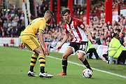 Brentford defender, Tom Field (39) attacking down the line during the Sky Bet Championship match between Brentford and Fulham at Griffin Park, London, England on 30 April 2016. Photo by Matthew Redman.