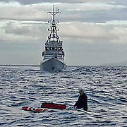 A German tourist was rescued paddle-boarding across the Channel wearing just a pair of shorts, a hat and fleece.<br /> <br /> The conclusion of one person's attempt to cross the Dover Straits from France to Britain this morning. Setting off at around midnight on a Stand Up Paddleboard, he made it approximately halfway across the busiest shipping lane in the world before being spotted by the sharp-eyed diving crew aboard Maverick. A call to the authorities and he was safely plucked from his predicament and taken into the care of the Border Force team on Valiant.<br /> <br /> It's a thorny issue, attitudes on both sides of the English Channel perhaps differ as much as the humanitarian differences of opinion. One thing is certain, this individual was lucky. As the calmer weather continues ahead of the winter storms, these foolhardy attempts to gain a better life will no doubt continue both here and elsewhere. At least he is safe and alive.<br /> <br /> Information just received would indicate that he was not after all a suspected illegal immigrant, which surely begs the question what exactly he was doing out there. It is understood that The Home Office are taking no further action. It is also interesting to note that the media are currently being actively discouraged to report these events, presumably in an effort to prevent information on the true number of similar cases falling into the public realm.<br /> Exclusivepix Media