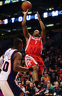 Jan. 6 2010; Phoenix, AZ, USA; Houston Rockets guard Kyle Lowry (7) puts up a shot against the Phoenix Suns guard Leandro Barbosa (10) at the US Airways Center.  Phoenix Suns defeated the Houston Rockets 118-110. Mandatory Credit: Jennifer Stewart-US PRESSWIRE