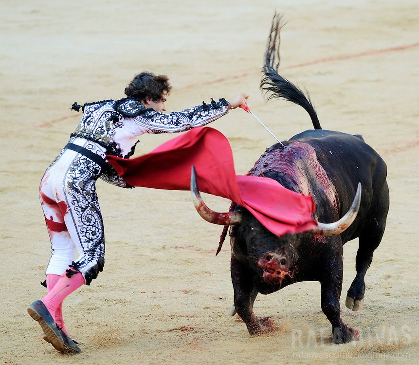 Spanish matador, Miguel Abellan kills with sword a fighting bull during the first corrida of the San Fermin festivities, in Pamplona, north of Spain, on July 7, 2008.
