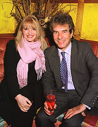 Actress PAT BOOTH and her husband DR GARTH WOOD,  at a party in London on 12th January 1999. MND 14
