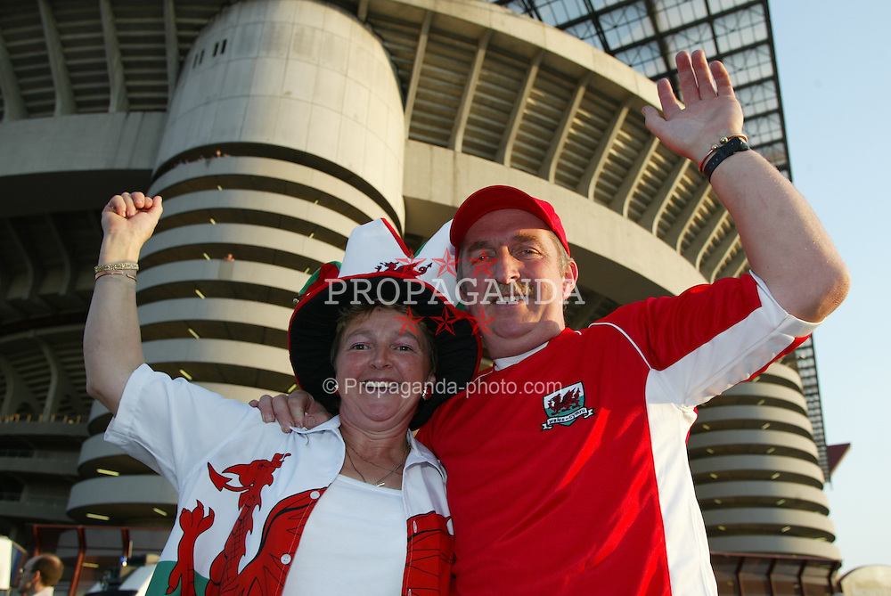 MILAN, ITALY - Saturday, September 6, 2003: Wales fans Mr & Mrs Williams from Pembrokshire who won a Wales on Sunday competition to Italy pictured outside the San Siro Stadium. (Pic by David Rawcliffe/Propaganda)