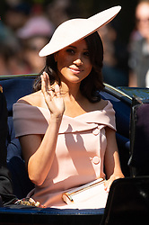 © Licensed to London News Pictures. 09/06/2018. London, UK. The DUCHESS OF SUSSEX rides in a carriage to attend the Trooping The Colour ceremony in London. This years event is part of a weekend of celebration to mark the 92th birthday of Queen Elizabeth II, who is Britain's longest reigning monarch.Photo credit: Ray Tang/LNP