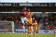 Northampton Town defender Jordan Turnbull (6) heads the ball  under pressure from Newport County midfielder Joss Labadie (4) during the EFL Sky Bet League 2 match between Northampton Town and Newport County at the PTS Academy Stadium, Northampton, England on 14 September 2019.
