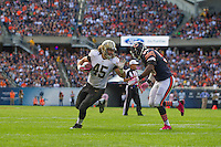06 October 2013: Fullback (45) Jed Collins of the New Orleans Saints runs the ball near the goal line against the Chicago Bears during the first half of the Saints 26-18 victory over the Bears in an NFL Game at Soldier Field in Chicago, IL.