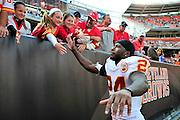 Sept. 19, 2010; Cleveland, OH, USA; Kansas City Chiefs cornerback Brandon Flowers (24) celebrates with fans after a 16-14 win over the Cleveland Browns at Cleveland Browns Stadium. Mandatory Credit: Jason Miller-US PRESSWIRE