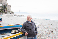 """CETARA, ITALY - 10 March 2014: Giuseppe """"Fragolino"""", a fisherman living and working in Cetara, is here by a boat on the beach of Cetara, Italy, on March 10th 2014.<br /> <br /> Daniele De Michele, aka Donpasta, is a DJ-economist with a passion for gastronomy who tries to combine his passions and knowledge into """"Food Sound System, political manual for musical gastronomy""""."""