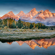 An autumn reflection during clearing weather in the Tetons near Jackson, Wyoming.