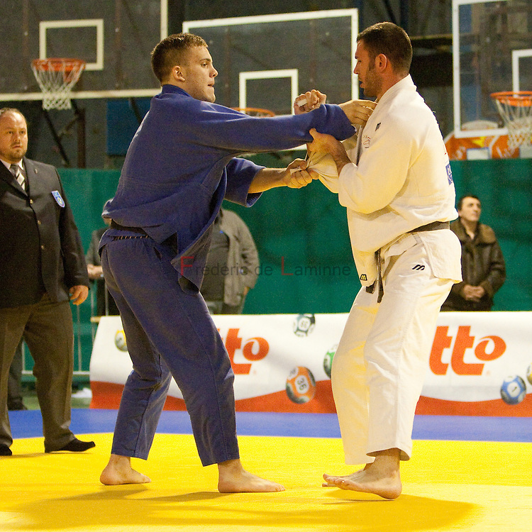 Visé - January 31 : Karl-Richard FREY (blue) from Germany compete with Jonathan LEININGER from France in the match for the 3rd place of Men's -100 Kg during the Judo Open International 2010 in Visé, Belgium. LEININGER won the match.