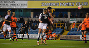 Steve Morrison with a headed effort during the The FA Cup match between Millwall and Flyde at The Den, London, England on 7 November 2015. Photo by Michael Hulf.